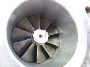 Remanufactured 6TC turbo with insert on exhaust housing